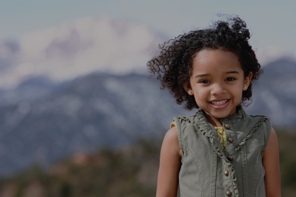 Young Girl In Front of Mountains