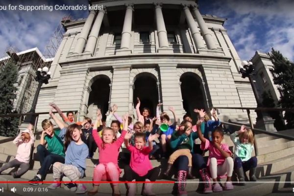 video screen shot of children in front of the state Capitol