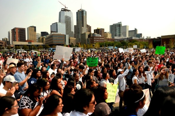 Students and advocates defending DACA in Denver last year. Photo by The Denver Post