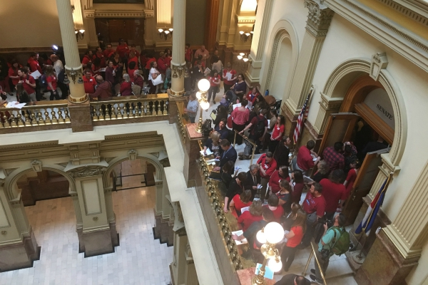 Teachers lobby at the state capitol for school funding