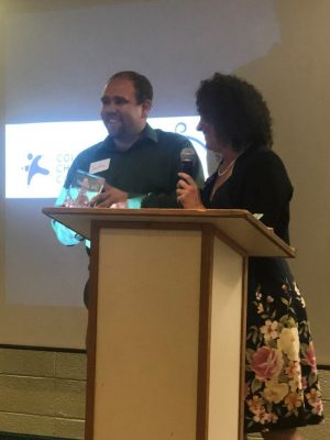 Justin Grantham accepts an award from ECHO & Family Center Early Childhood Council on behalf of his father, Sen. Kevin Grantham, for his service to Fremont County children and families as a state senator.