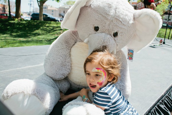 a child holding a large stuffed animal
