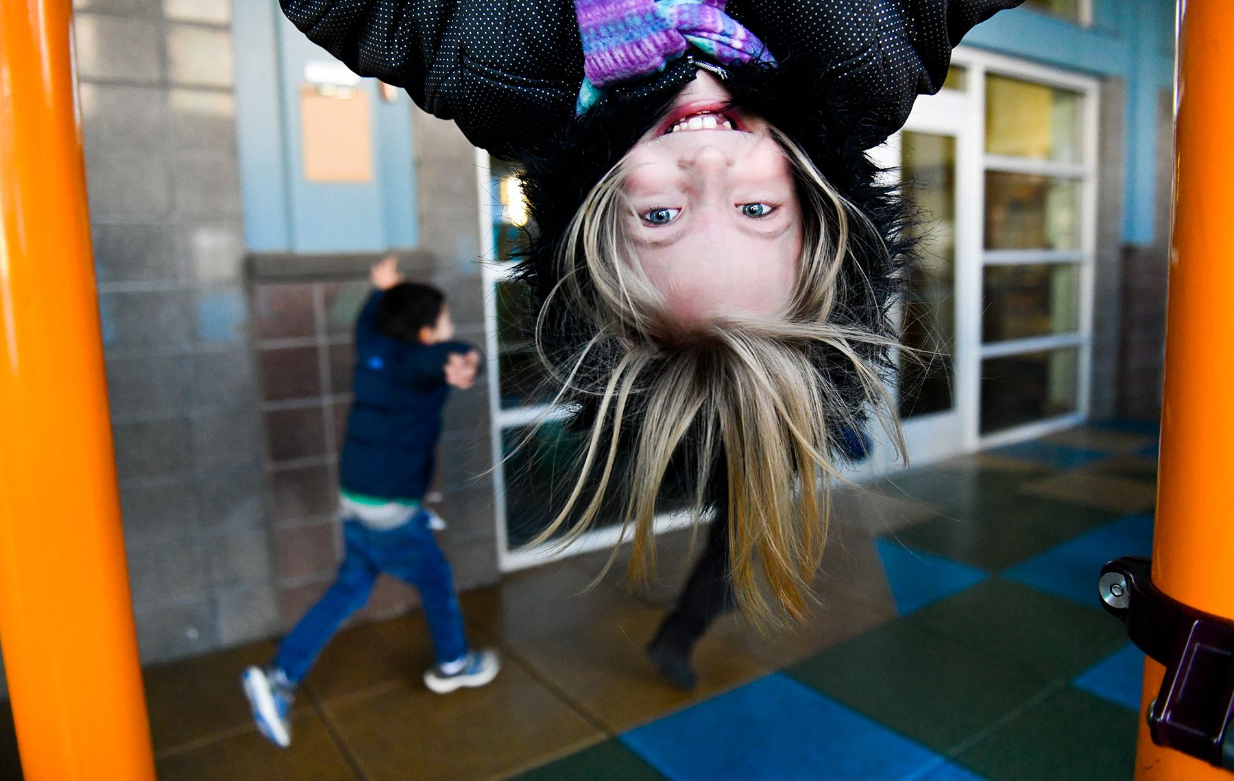 kindergartner upside down