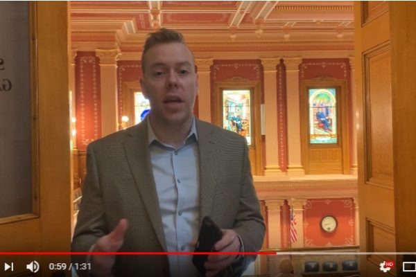 Riley Kitts explaining week six at the Colorado State Capitol