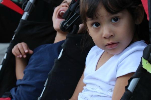 a child in a stroller