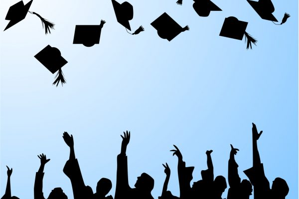 Graduation caps in the air