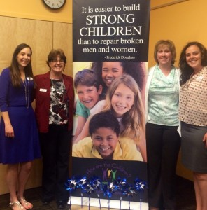 From left to right: Research Director, Sarah Hughes; IAK Leaders, Colleen Roahring and Holly Jacobson; and Research Analyst, Lily McKoy at the 2014 KIDS COUNT in Colorado! presentation in Grand Junction.