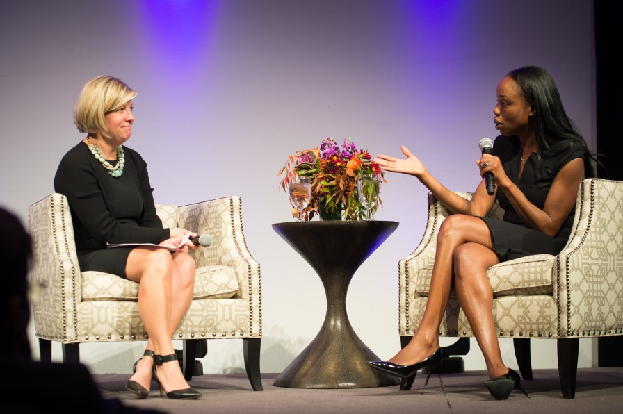 Chris Watney, President and CEO of the Colorado Children's Campaign, speaks with Dr. Nadine Burke Harris at the 2014 Annual Luncheon Tuesday. Photo by KelliePhoto.com
